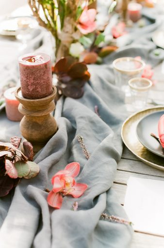 grey table runner with orchids and candles