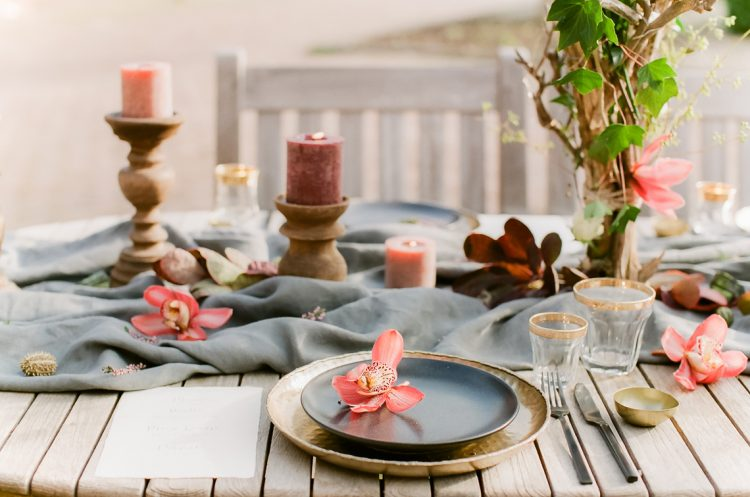 place setting and tablescape with pink orchids and grey runner