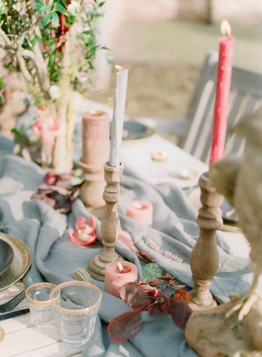 fine art table setting with grey runner and runner of candles