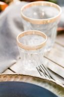 glass wine goblets with gold trim