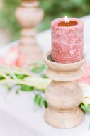rustic candle holder and pink wax candle
