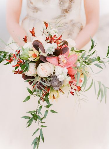 bridal bouquet with orchids and foliage