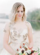 details of the brides dress and golden embroidery