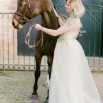 portrait of a bride ad her horse