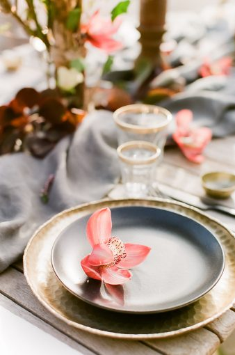 place seting with pink orchid displayed on the plate
