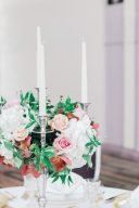 floral centrepiece design with candelabra and taper candles