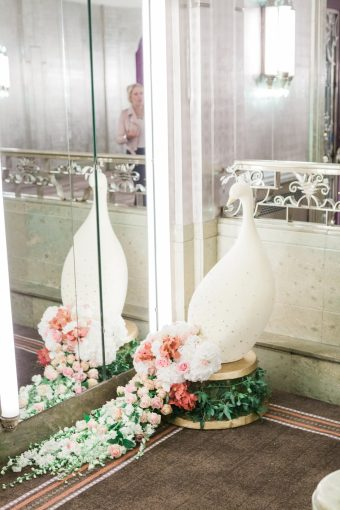 elegant wedding decor details with bird and florals