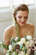 bridal portrait wearing a fishtail plait braided hair style
