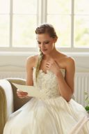 bridal portrait reading a love letter