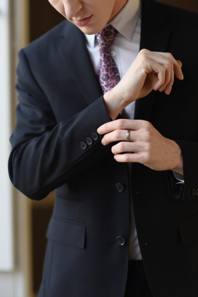 groom fastening his cufflinks
