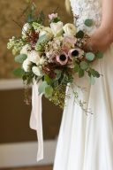 bride holding a fine art bouquet with silk bouque ribbons