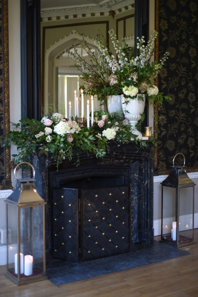 fireplace decorated with florals for the wedding