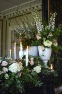mansion fireplace decorated with wedding flowers