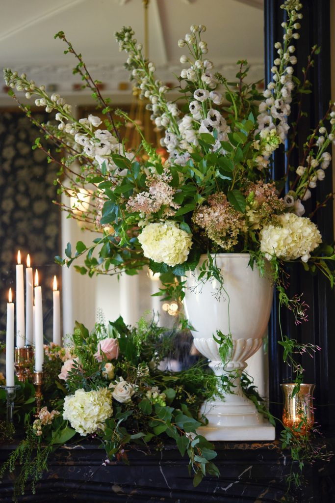 taper candles and urn of florals
