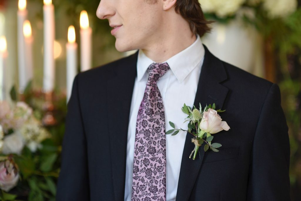 classic groomswear with a pink tie and boutonniere