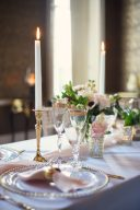 wedding table decor with tapered candles and peach silk runner