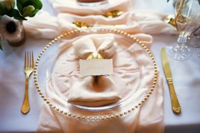 glass charger with blush silk table runner