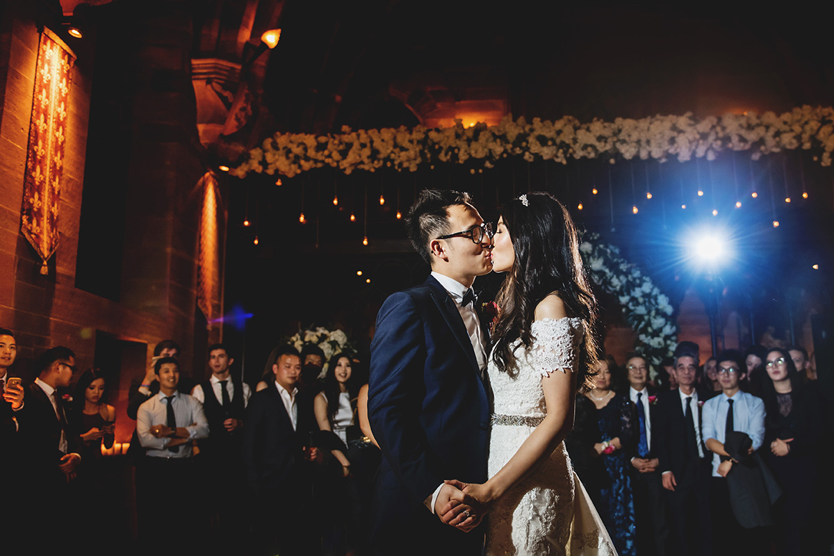 bride and groom share a kiss during their first dance