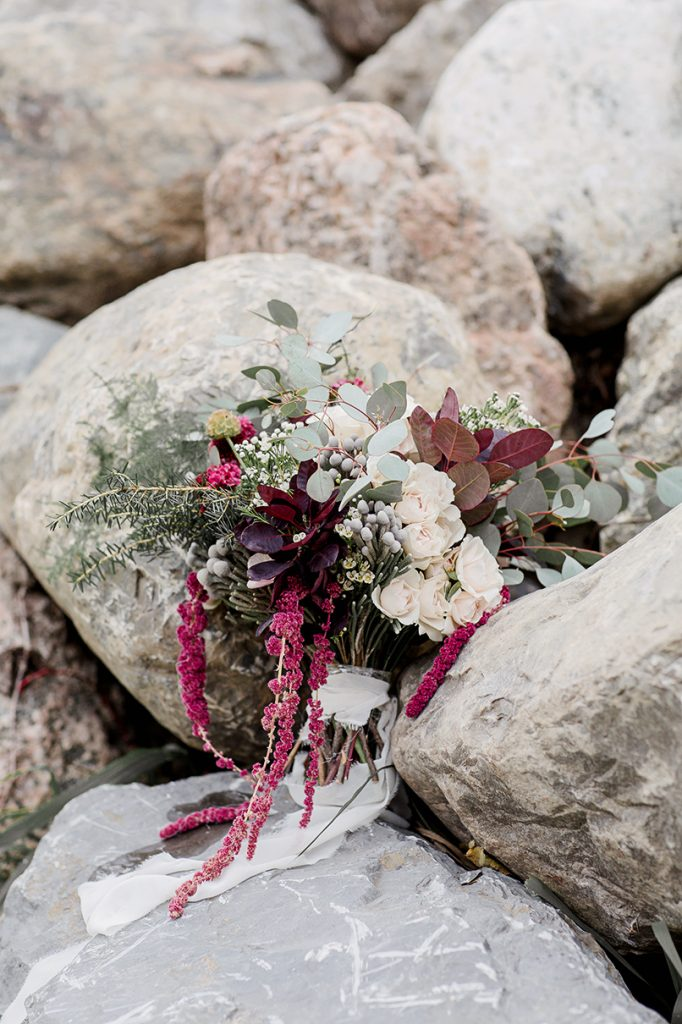 winter wedding bouquet in blue white and burgundy with eucalyptus