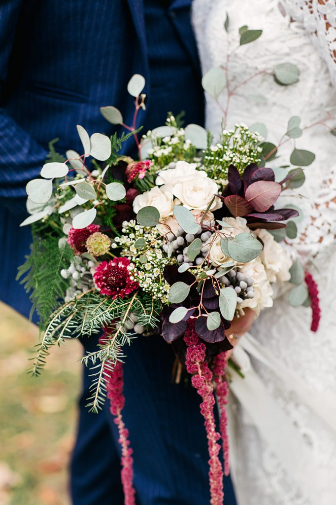 winter wedding bouquet with eucalyptus white blue and burgundy