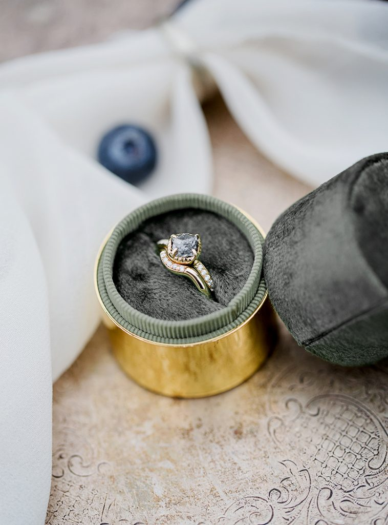 round velvet ring box with gold edge by esselle and modern engagement ring