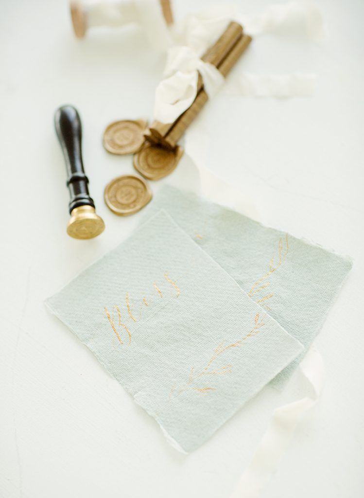 watercolour and calligraphy wedding stationery in pale blue with gold wax seals
