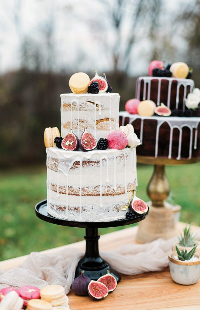 two tier undressed naked wedding cake with buttercream and topped with figs