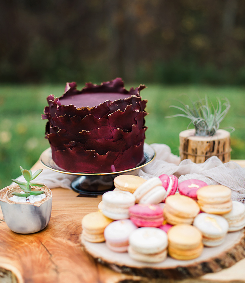 contemporary wedding cake selection with modern burgundy cake edged in gold