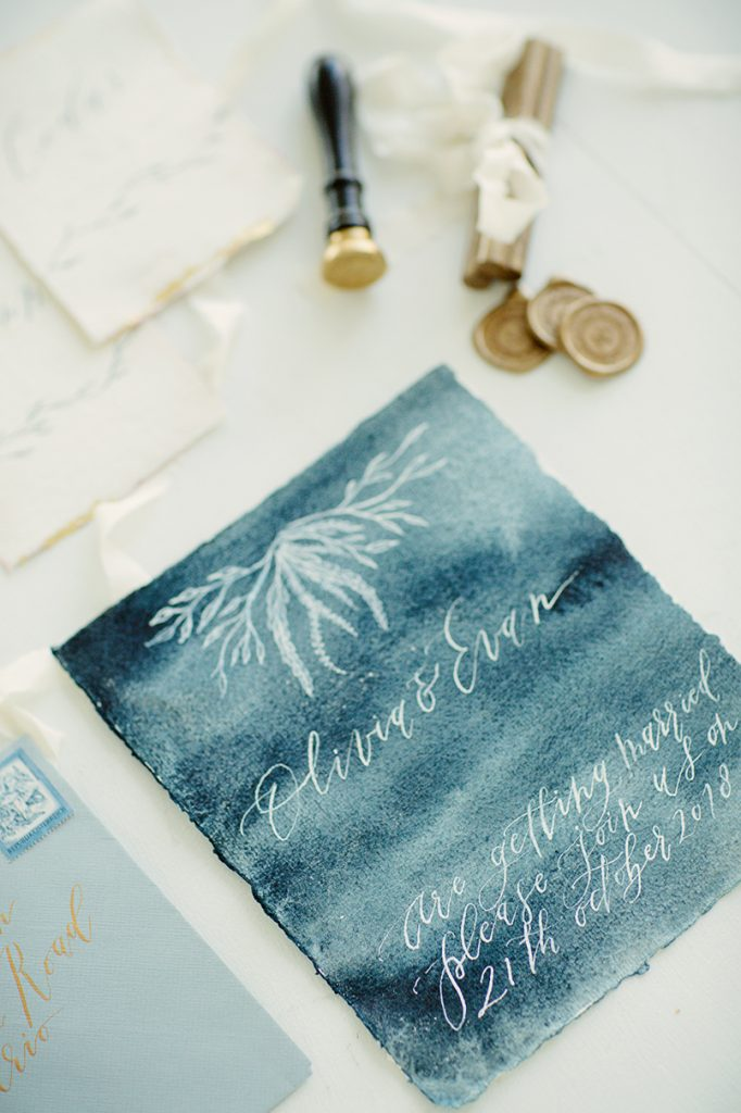 watercolour and calligraphy wedding stationery with gold wax seals