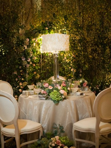 luxurious garden display for wedding with table setting