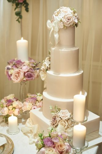 luxurious 5 tier wedding cake and floral display