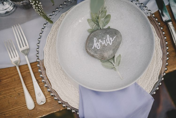 wedding place setting with spring of eucalyptus and stone place card