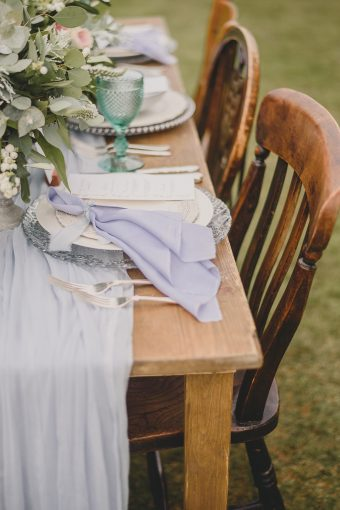 wedding table decor with blue silk runner and napkins