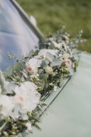 classic wedding car decorated with flowers