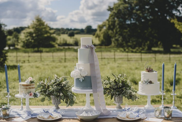 romantic wedding dessert table with different cakes
