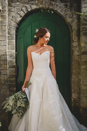 bridal portrait with door fram and stonework