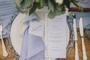 wedding place setting and deocr with blue napkin and menu design