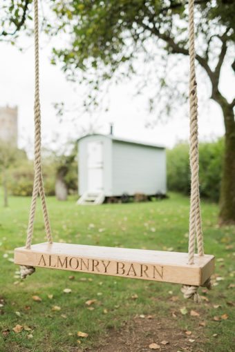 wooden swing at almonry barn