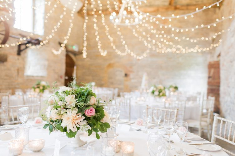 fairylight canopy hung over the wedding reception tables at almonry barn