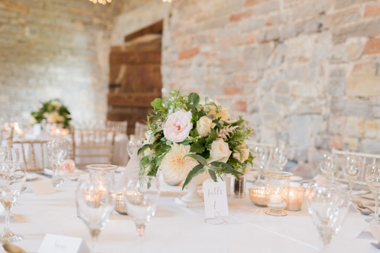 romantic wedding table deocr with floral centrepiece at almonry barn