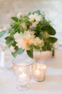 wedding table decor tealights and hurricane lanterns