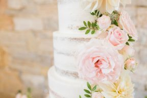 pretty pastel pink roses on the naked wedding cake