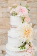 huge dahlia and roses decorating the naked wedding cake