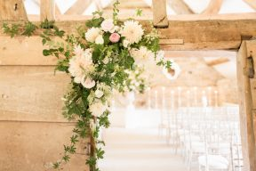 florals decorate the door frame at almonry barn