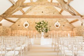 ceremony space at alomonry barn with white bamboo chairs