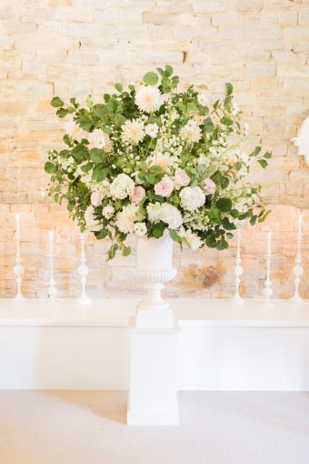 statement floral design in the ceremony space at almonry barn