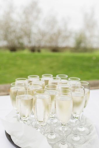 glasses of sparkling chmpagne for wedding guests