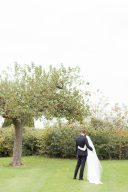 bride and groom portrait under an apple tree