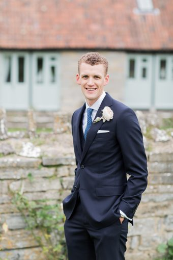 sophisticated modern groom attire with navy suit