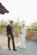 elegant bride and groom in the grounds of almonry barn